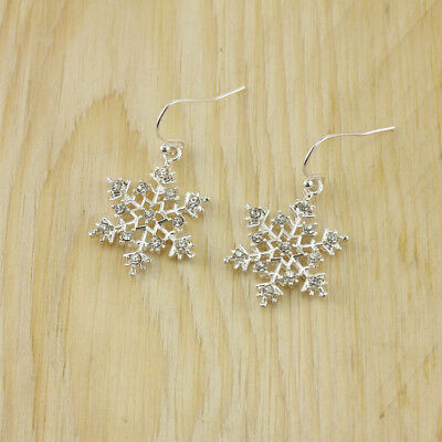 Silver colour snowflake dangle earrings with crystal