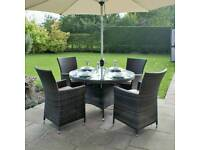 Brown rattan garden table and chairs with parasol