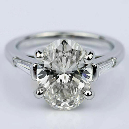 Three Stone Baguette 2.18 Carat Oval Diamond Engagement Ring White Gold E VS1