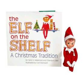 Elf on the shelf with book