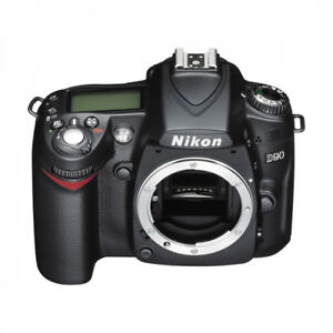 Nikon D90 Camera with Batteries, Charger and Books