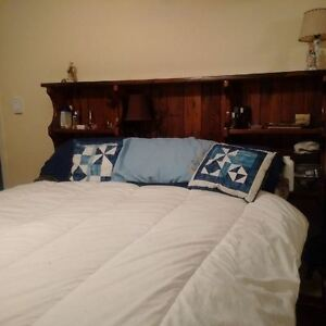 Queensize bed with 12 drws/bookcase headboard/pillow top mattres