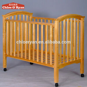Nearly new wood 3-in-one crib
