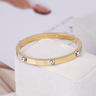 Henri Bendel Gold Metal Rivet Logo Crystal Bangle Bracelet - Petite