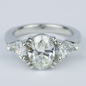 Oval And Pear Moissanite Engagement Ring In 14k White Gold
