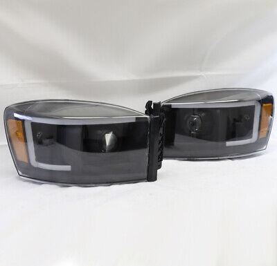FOR 06-08 DODGE RAM 1500 2500 3500 LED PROJECTOR HEADLIGHTS HEADLAMP BLACK USED