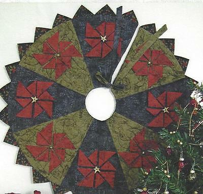 Prairie Point Poinsettia tree skirt quilt pattern by Happy Hollow for (Poinsettia Tree Skirt)