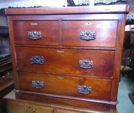 A Victorian walnut bedroom chest of three long drawers