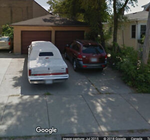 Double car garage and storage for rent with two paved parking