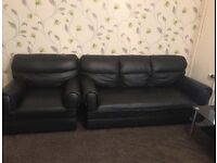 Black leather sofa with Table