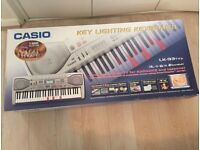 Casio LK-93TV 61 Full Size Key Lighting Electronic Keyboard with stand