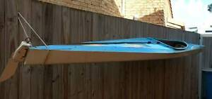 Kayak with rudder and paddle