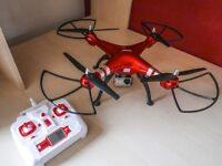 Syma X8HG quadcopter drone with 8MP HD camera and spare battery - hardly used