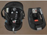 Cybex Aton 2 car seat with Cybex Aton isofix base and a seat raincover