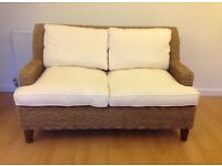 Lovely Conservatory/dining room settee with removable cream covers.
