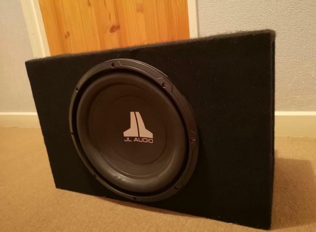 """12"""" jl audio subwoofer, base bin and amp"""