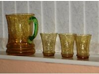 AMBER CRACKLE-GLASS JUG WITH GREEN HANDLE AND THREE AMBER GLASSES - PRICE NOW REDUCED