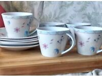 Tea cups and saucers. Rosemoor by Queens. Original Artwork by by Lilian Snelling