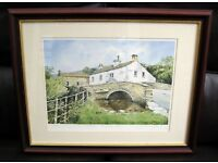 Framed numbered print with certificate, The bridge at Malham, by John Rudkin.
