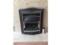 Electric gas fire. With timber surround