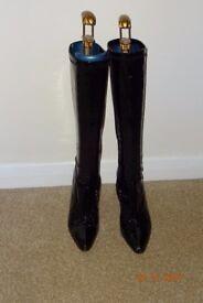 Ladies black patent knee length boots