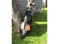 Boys golf clubs and bag