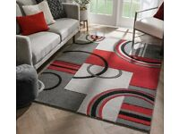 Red/Black and grey rug new in packaging