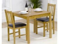 Small oak dining room table and 2 chairs