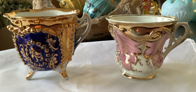 Porcelain Mugs or antique Cups German with Ornate gold designs and patterns