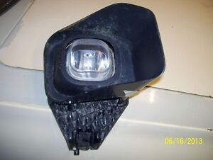 2011 Ford F350 right fog lamp with mounting bracket and bezel