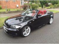 Black//2010 BMW//1 SERIES