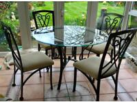 Glass topped dining table & 4 matching chairs