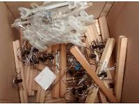Box of wooden kids trouser hangers