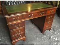 Green leather pedestal desk...