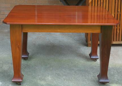 Antique Small Polished Hoop Pine Dining Table on Casters.