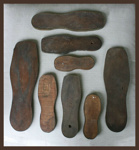 lot of 8 antique wooden shoe sole templates with tin edging for cutting