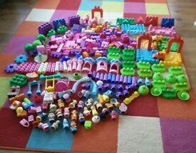 Mega blocks on floor and mega blocks pink heart storage box collect Stonehaven
