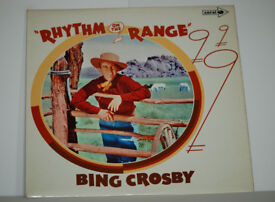 Bing Crosby Rhythm On The Range Album. Record in excellent condition. Sleeve in quite good condition