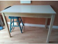 A vintage retro white formica top and wooden kitchen table mid century