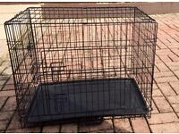 dog cages [hardly used ] 1 small and 1 medium