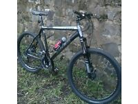 TREK MOUNTAIN BIKE, COMES WITH SHIMANO SLX 27 SPEED GEARS AND REMOTE LOCKOUT SUSPENSION £200
