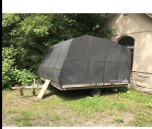 Double tilt enclosed snowmobile trailer