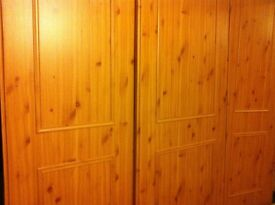 3 PINE EFFECT SLIDING WARDROBE DOORS COMPLETE WITH NEW TRACK.