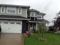 Two story NW High River home for sale
