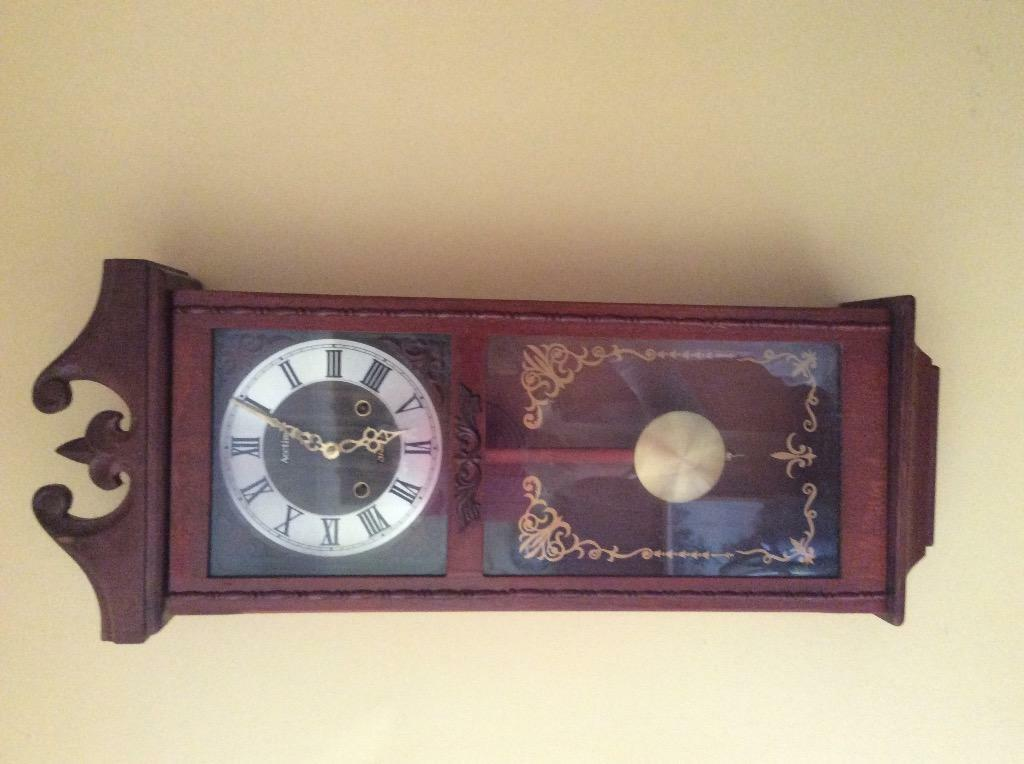 wall clock with pendulum buy sale and trade ads great