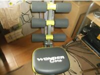 wonder core fitness machine with users gide