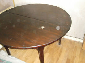 BROWN ROUND DINING TABLE