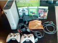 Xbox 360 arcade with 2 controllers and three games