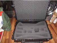 Black Peli 1650 case, 4 wheels and retractable handle, lifetime guarantee,ideal for camera equipment