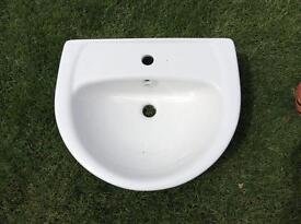 Semi recessed basin.